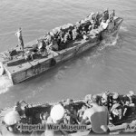 Indian troops embarking from the cruiser HMS KENYA
