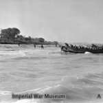 Royal Marines of HMS KENYA dashing ashore on the beach at Cheduba