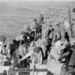 Royal Marines return to their cruiser HMS KENYA off Cheduba