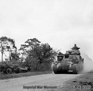 Tank moves up to support the 26th Indian Infantry Division on Ramree Island