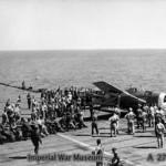 Men helping to clear a crashed Grumman Hellcat